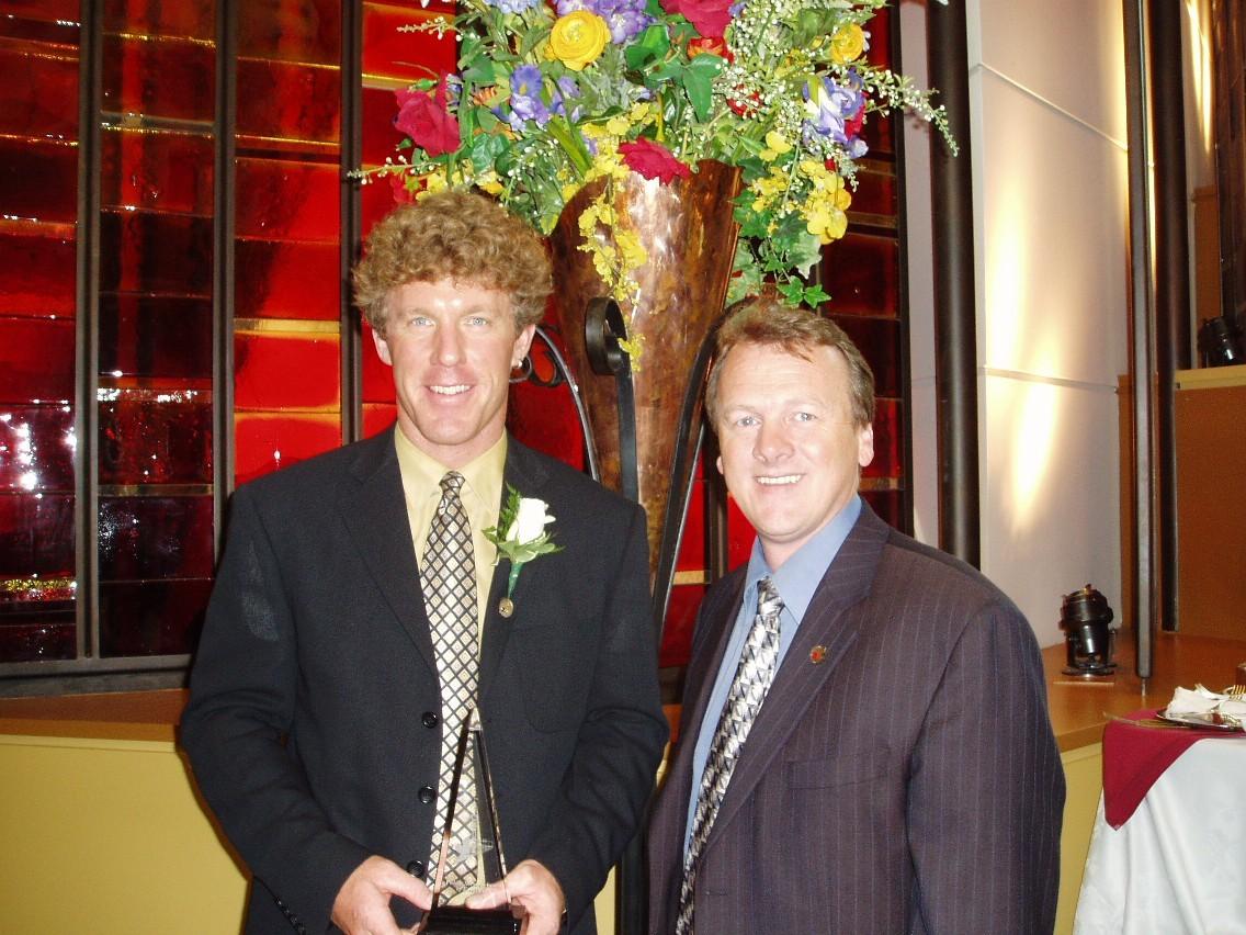 6 Grant Statham Receiving Public Service Award from Alan Latourelle